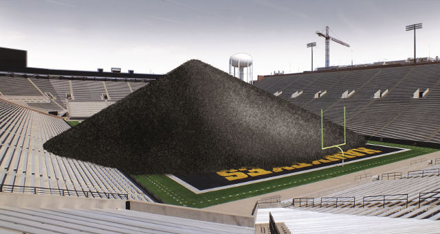 The University of Iowa Power Plant burns 93,000 tons of coal annually. If that was piled on the 50-yard line at Kinnick Stadium, the mount would be over 100 feet tall, cover the playing field and extend into the stands. And, that's only a fraction of the university's coal use: The power plant only generates 20-30 percent of the UI's energy. -- image by Adam Burke