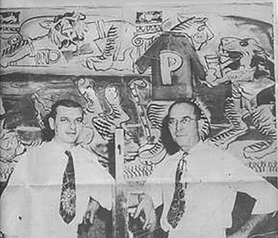 James Wallace, former owner, in front of tiger murals that were painted on the walls of George's. -- photo courtesy of Mike Karr