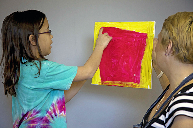 Tami Recker works with young artists to help grow their art. -- photo by Jamy Schumacher
