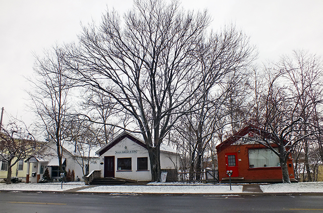Three cottages on South Dubuque Street are facing demolition. Photo by Adam Burke