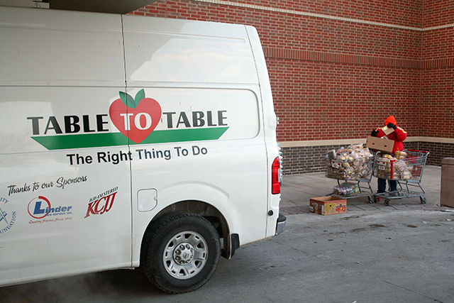 A table to Table van is loaded with baked goods before heading to Salvation Army and Johnson County Crisis Center Food Bank. -- photo by Adam Burke