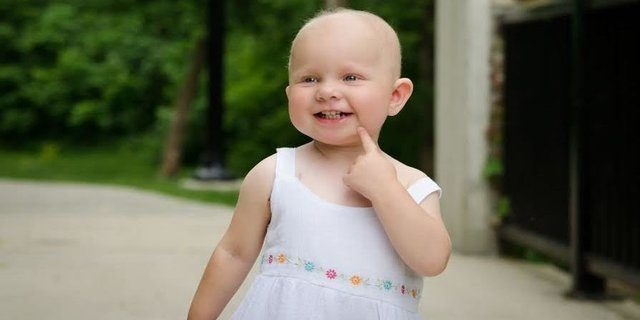 Laughing for a good cause saves smiles like Avery's --photo by Little Steps Photography
