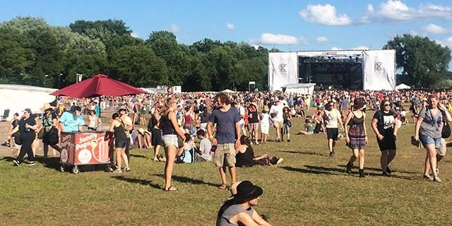 Festival-goers mill around the field between sets --photo by Silas Valentino