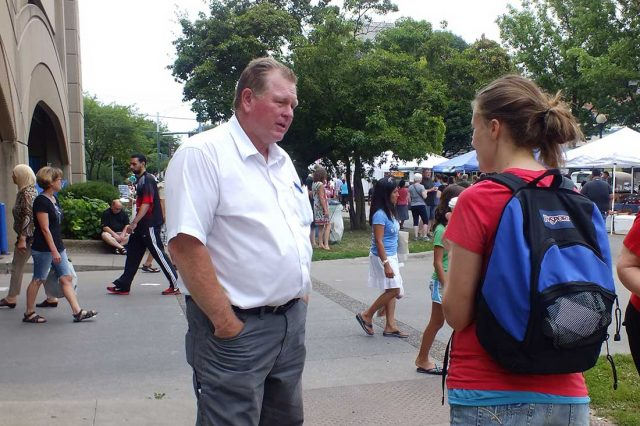 Phil Hemingway talks with a voter at the Iowa City Farmers Market -- photo by Adam Burke