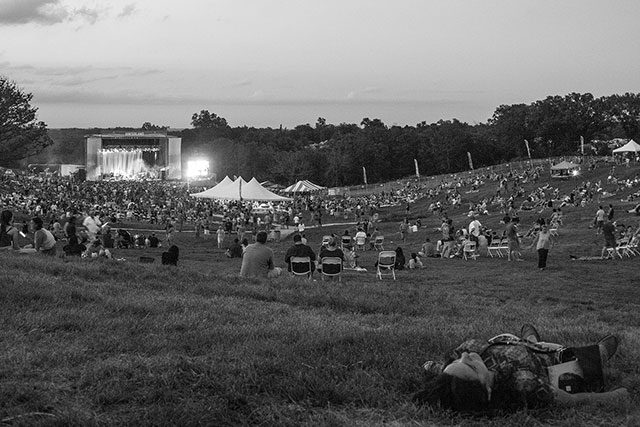 Hinterland festival-goers relax in the prairie outside St. Charles, Iowa --Photo by Matthew Terry