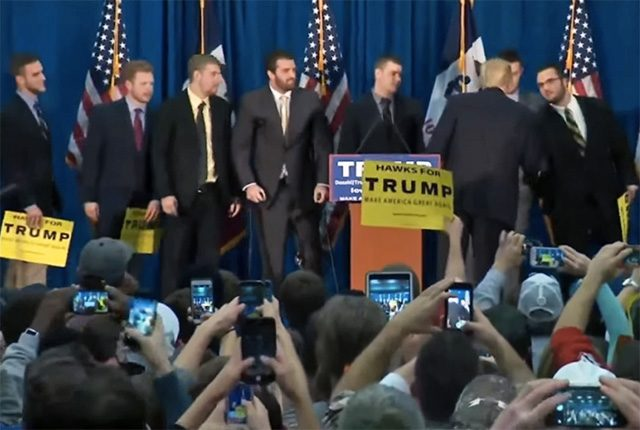 Trump shakes hands with members of the Hawkeyes football team. -- video still via YouTube