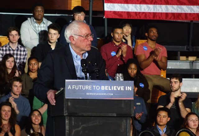 Sanders read his speech from prepared notes, tailored for the young college students who comprised most of the audience. He talked about climate change, student debt and how he would pay for free higher education (with a tax on Wall Street speculators) and reduce the penalty for marijuana possession -- photo by Adam Burke