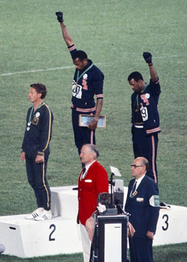 American sprinters Tommie Smith and John Carlos protested racial discrimination at the 1968 Olympics.-- photo by Angelo Cozzi