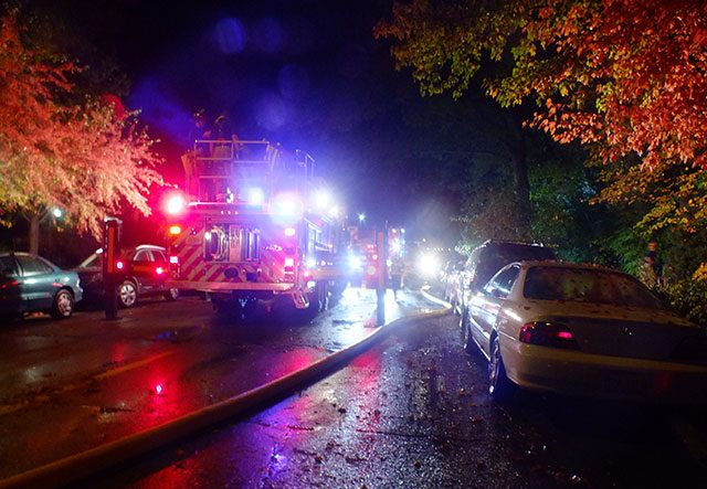 Fire truck fight the Breder blaze at 623 College St. on Oct. 20, 2015. -- Photo by Adam Burke