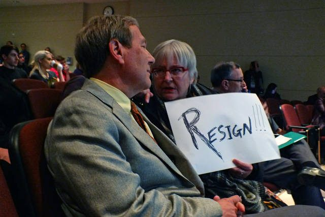 Harreld with a front-row protestor. -- photo by Adam Burke