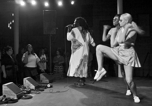 Tunde Olaniran takes the stage with his dance team -- photo by Matthew Terry