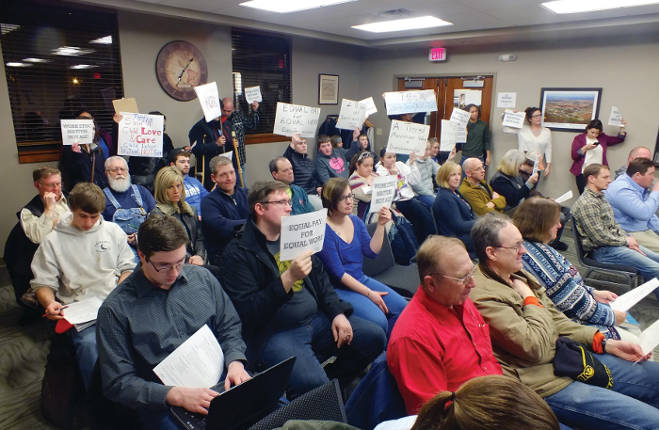 Young protestors gather at a Tiffin City Council meeting. -- photo by Adam Burke