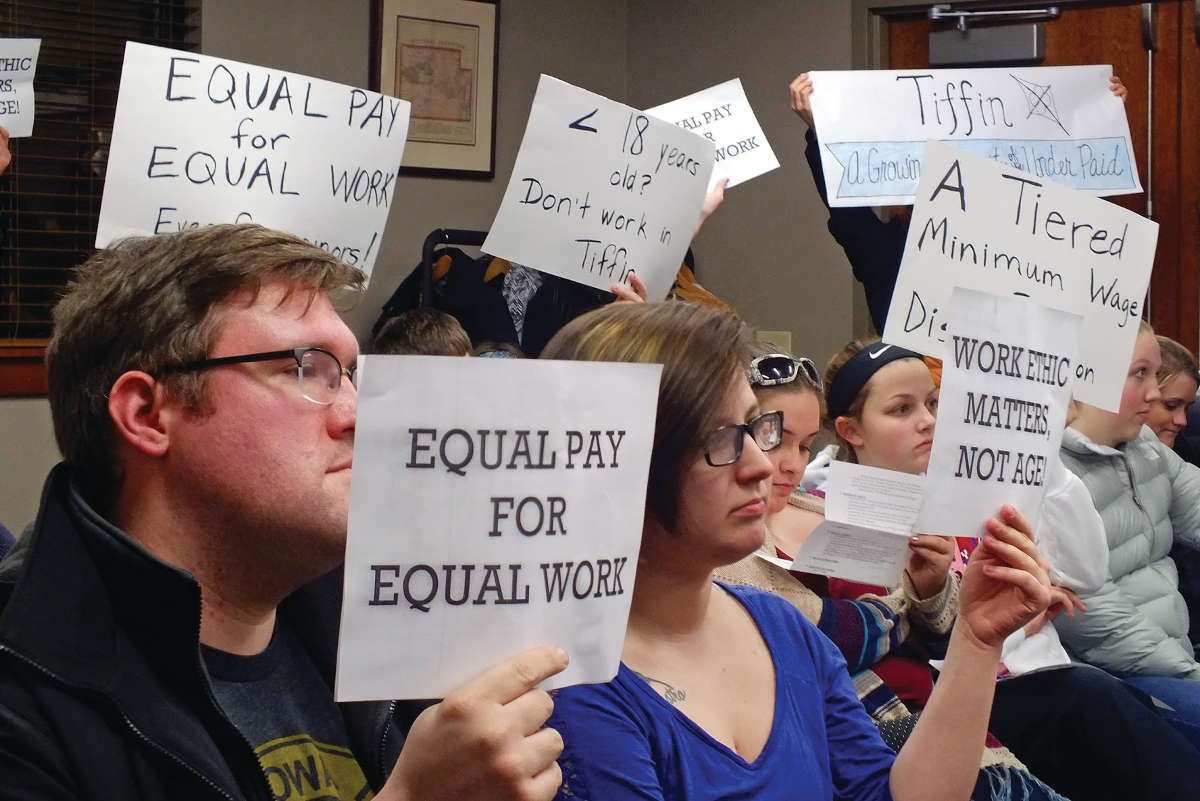 Supporters of a higher minimum wage for all workers, including those under age 18, attend a Tiffin City Council Meeting in 2016. -- photo by Adam Burke