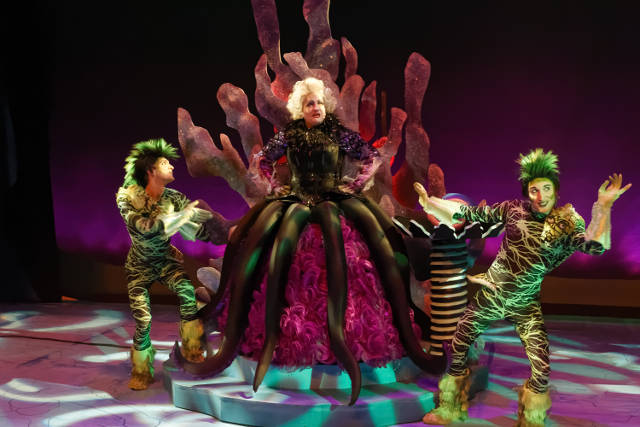 Marcia Hughes as Ursula, flanked by Aaron Canterbury (L) as Jetsam and Jay Burken as Flotsam -- photo by Struttmann Photo