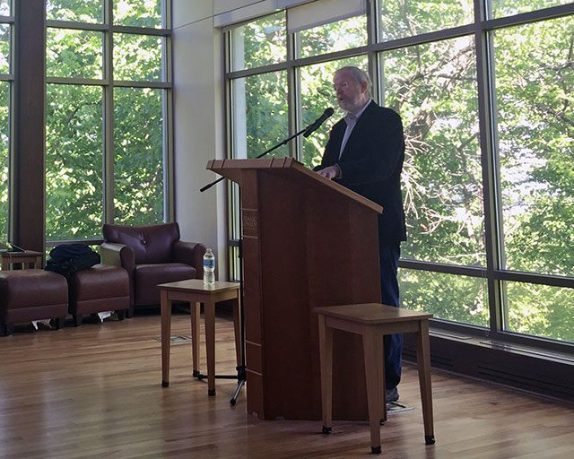 Bill Bryson speaks at the Writers' Workshop -- photo by Tim Taranto