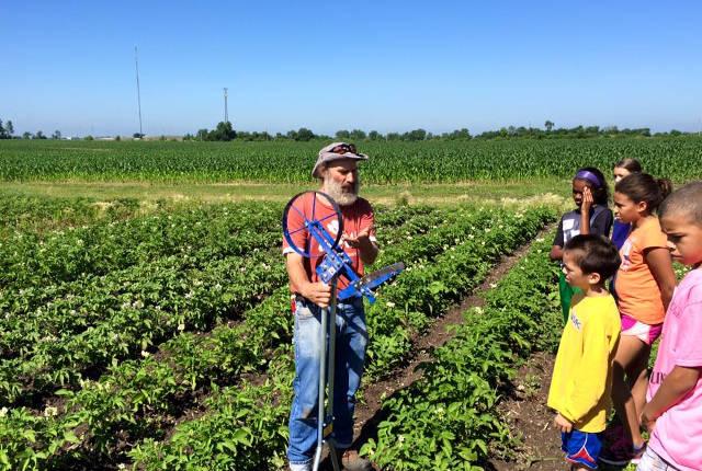 Scott Koepke, Grow: Johnson County's garden educator, speaks to a group of children -- photo by John Boller