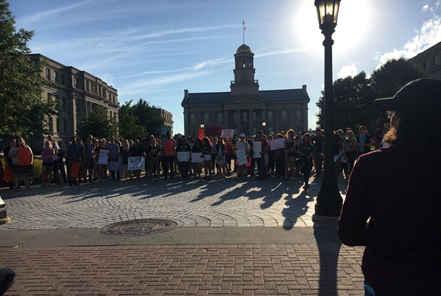 Upwards of 100 people gathered on the University of Iowa Pentacrest in Iowa City, Iowa for a peaceful protest against police brutality -- photo by Cassandra Santiago