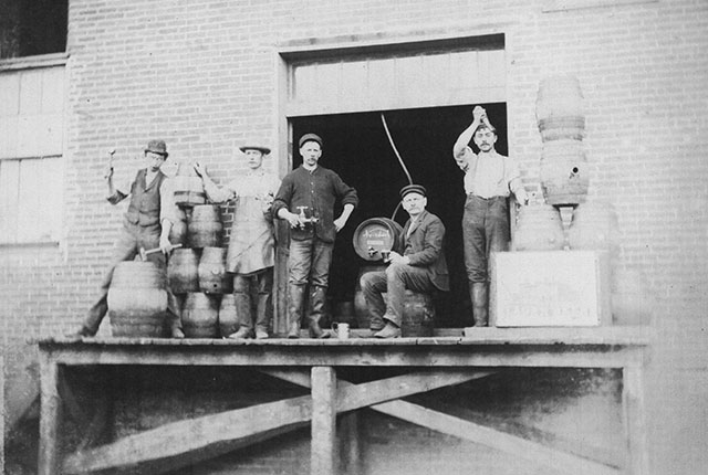 Men pose on the delivery dock of an IC brewery. Photo courtesy of Johnson County Historical Society