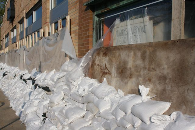 Sandbags were piled in front of Lion Bridge Brewing Company and  the Copper Alligator on Saturday, Sept. 24, 2016 in the Cedar Rapids Czech Village. -- photo by Lauren Shotwell