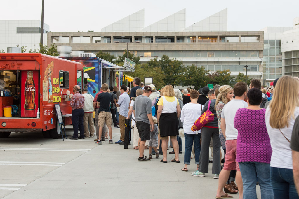Concert goers line up to get a bite from the Don Diego, Island Vybes and Marco's food trucks. Friday, Sept. 16, 2016. -- photo by Zak Neumann
