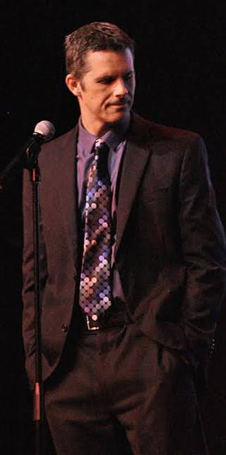 Event organizer Nathan Timmel at last year's Comedy for Charity event -- photo courtesy of Nathan Timmel