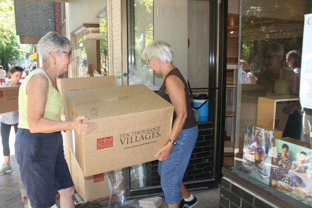 Volunteers unload boxes of merchandise for the new Ten Thousand Villages location, which opens in October. -- photo by Lauren Shotwell