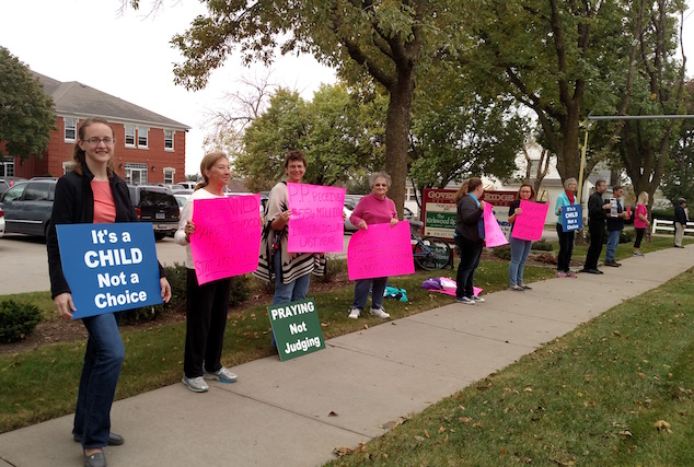 Picketers stood outside the Kirkwood Room in Iowa City during a Hillary Clinton campaign event headlined by Planned Parenthood president Cecile Richards on Oct. 5, 2016. -- photo by Lauren Shotwell