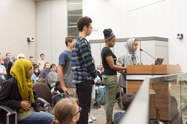 Lujayn Hamad and fellow students lay out a list of demands to the Iowa City Council. The list included immediate and long-term steps toward making their schools more inclusive and safe. Tuesday, Nov. 15, 2016. -- photo by Zak Neumann