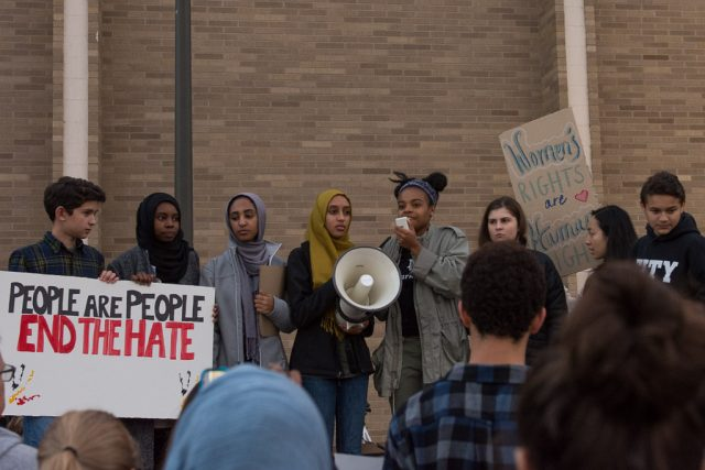Students from City and West high schools address hundreds of people gathered for their anti-hate march outside Robert A. Lee Community Recreation Center. The students said they organized the march after multiple instances of harassment went ignored by faculty and staff at the high schools. Tuesday, Nov. 15, 2016. -- photo by Zak Neumann