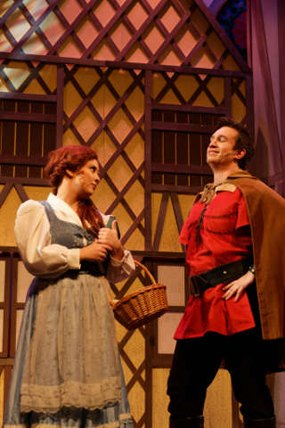 Erin Helm as Belle; Dustin Davis as Gaston -- photo by Struttmann Photo