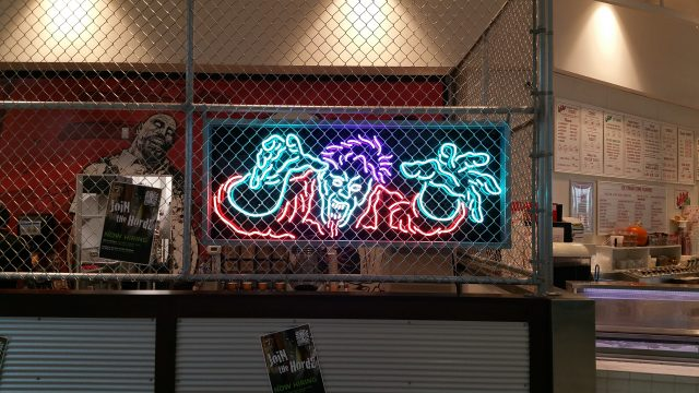 A neon zombie welcomes patrons at the Coral Ridge Mall location. -- photo courtesy of Orchestrate Hospitality