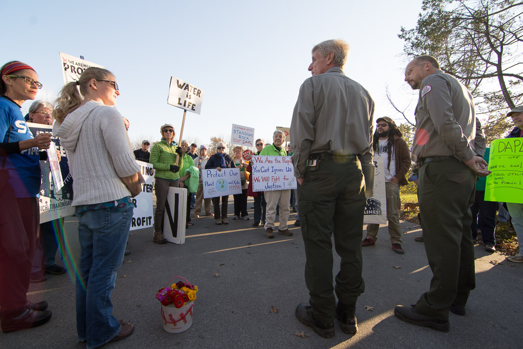 Army Corps of Engineers rangers Jeff Peck and Doug Vogel listen to community members' concerns about the Dakota Access Pipeline outside of their offices near the Coralville Dam on Tuesday, Nov. 15, 2016. -- photo by Zak Neumann