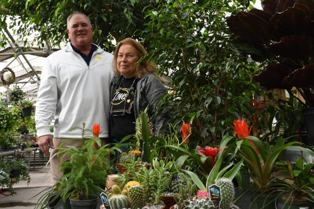 Kerry and Aleda Feuerbach posed in the greenhouses of the Pleasant Valley Garden Center and Flower Shoppe in Iowa City on Monday, Nov. 14, 2016. After six decades, the family business will be closing in January 2017. -- photo by Zak Neumann