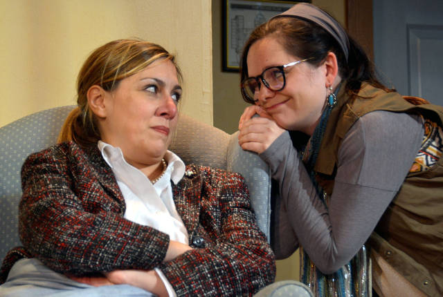 Kristy Hartsgrove Mooers (l) and Cara Clonch Viner share a moment in 'The Taming' -- photo by Riverside Theatre