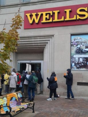 Dakota Access Pipeline protesters enter Wells Fargo in Iowa City on Wednesday, Nov. 30, 2016 to occupy the bank lobby and read the letter addressed to the Wells Fargo CEO Timothy Sloan. -- photo by Eleanore Taft