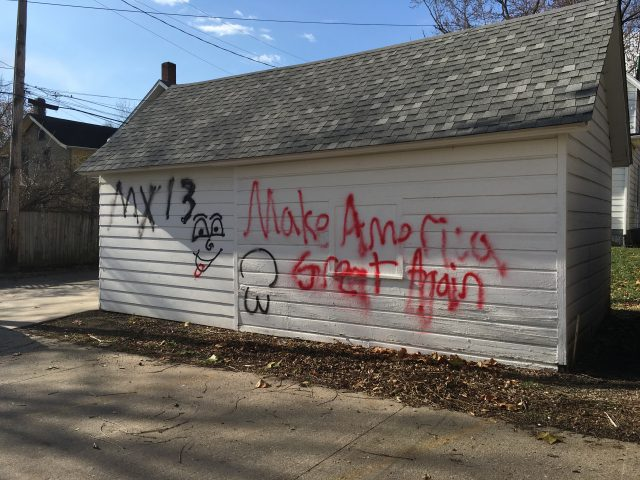 """Campaign slogan of president-elect Donald Trump, """"Make America Great Again,"""" marks the side of a apartment building's garage. -- photo by Kelli Ebensberger"""