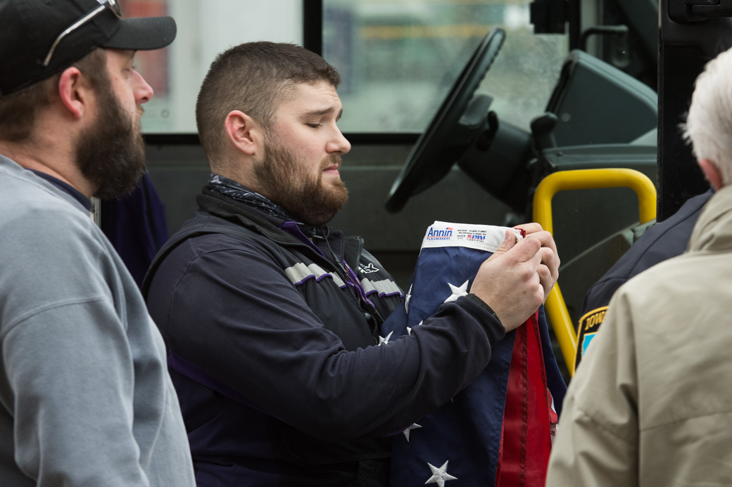 Matt Uhrin speaks with police after taking flags from protestors on Thursday, Jan. 26, 2017. -- photo by Zak Neumann