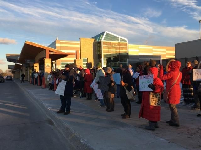 Protesters at the Eastern Iowa Airport Sunday, Jan. 29. -- photo by Eleanore Taft