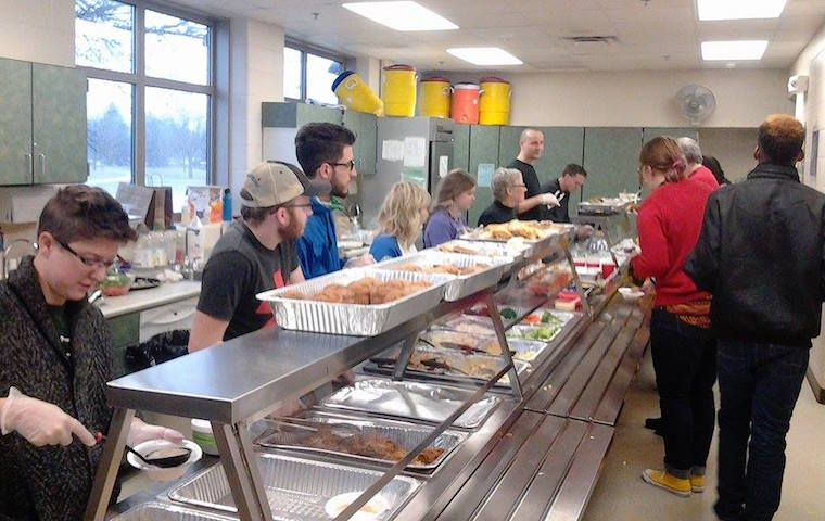 Attendees grabbed lunch during the Jan. 16, 2017 celebration of Rev. Dr. Martin Luther King Jr. at Iowa City's Grant Wood Elementary. -- photo by Eleanore Taft