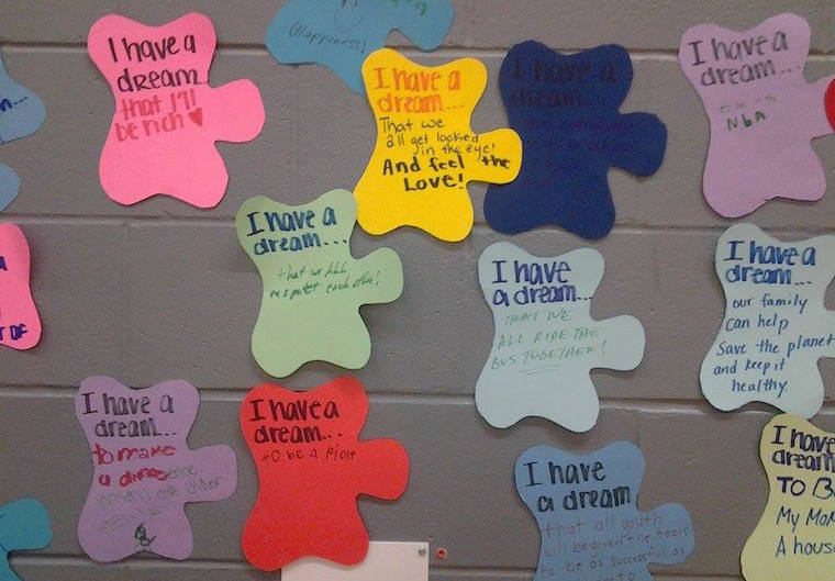 """Kids wrote about their dreams, families, injustices they'd seen at school and anything else that moved them for an """"I Have a Dream"""" wall during the Jan. 16, 2017 celebration of Rev. Dr. Martin Luther King Jr. at Iowa City's Grant Wood Elementary. -- photo by Eleanore Taft"""