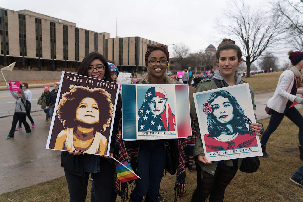 Marchers hold up posters during the Des Moines Women's March on Saturday, Jan. 21, 2017. -- photo by Mei-Ling Shaw