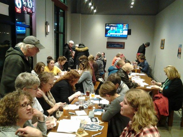 Iowa City Brewlab was packed with locals making their voices heard in Des Moines and D.C. -- photo by Eleanore Taft