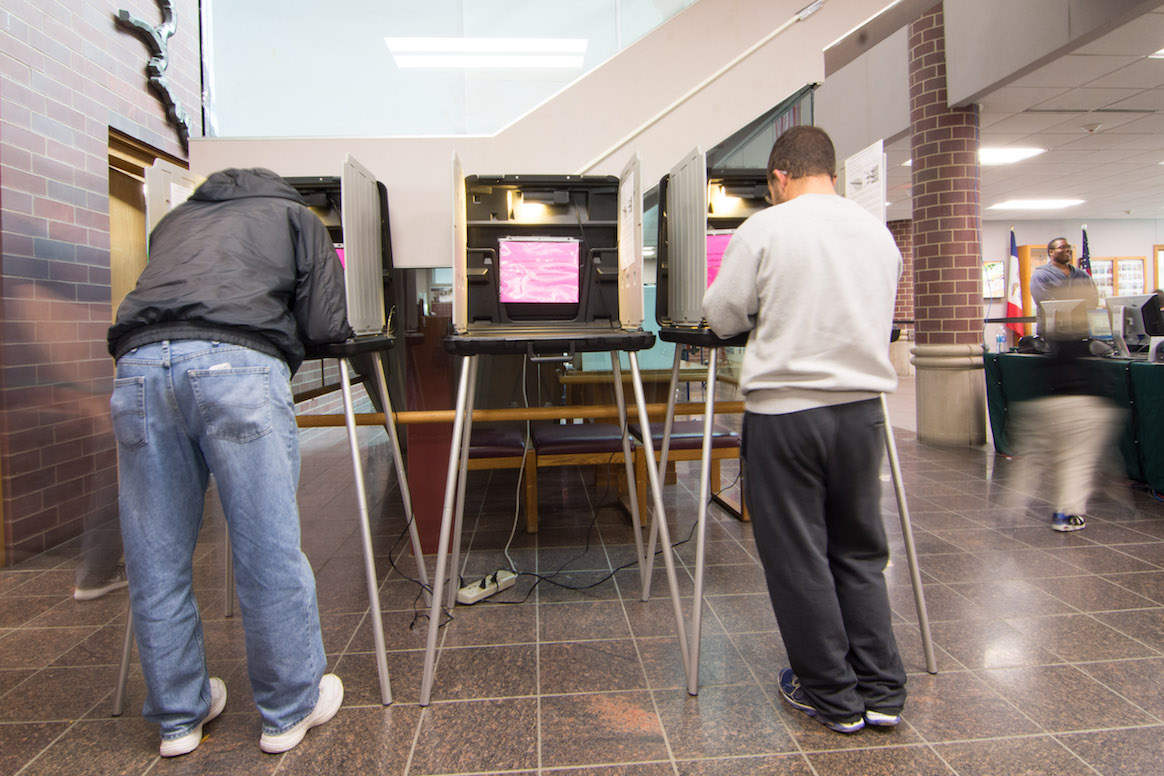 Individuals participate in early, in-person absentee voting at the Johnson County Administration Building in Iowa City on Oct. 26, 2016. -- photo by Zak Neumann