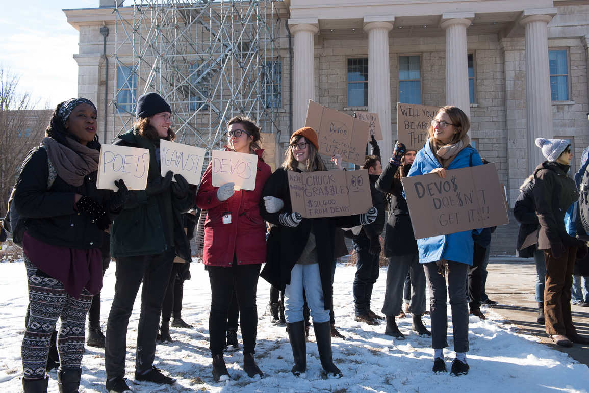 Students gather to oppose the confirmation of Betsy Devos as the secretary of education on the Iowa City Pentacrest, Wednesday, Feb. 8, 2017. -- photo by Zak Neumann