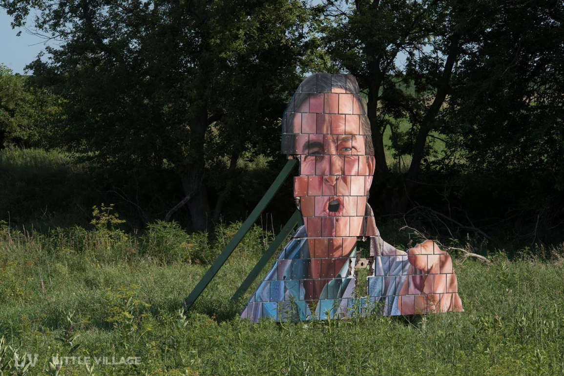 Your Village: What are those huge faces along I-80 in Iowa City
