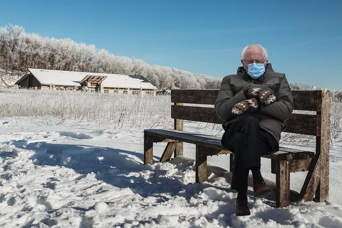 Bernie Sanders Stays Warm Becomes A Meme Starts Popping Up In Iowa City Cedar Rapids And Marion Little Village